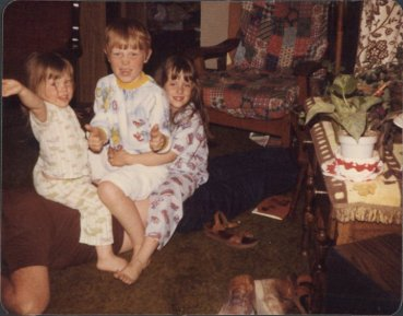 Me, my brother and our middle younger sister sitting on our dad - his idea of back massage.